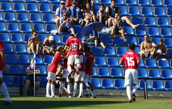 Los jugadores onubenses celebran el gol de Enrich. / LOF